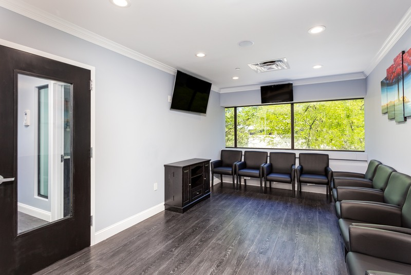 front office of oral and maxillofacial surgery of fairfield county with chairs and a tv