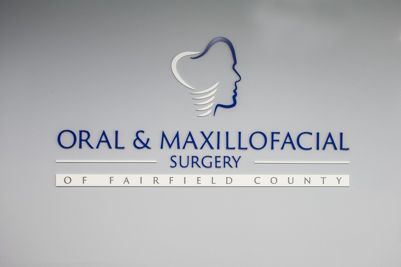 oral and maxillofacial surgery of fairfield county logo on the wall of the office